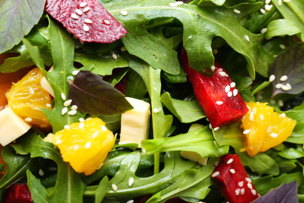 Tasty salad with arugula leaves, closeup